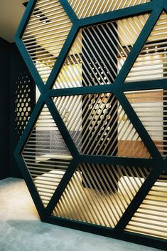Interesting interior metal with black framed wall. The panes and pattern resembles a geodesic dome design from Buckminster. Fuller RC13 on Behance