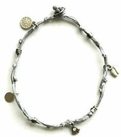 "Silver Ankle Bracelet with Good Luck Charms MIZZE Made for Luck Jewelry. $34.99. Charms include Hamsa, Hearts, stars and small coins. Beautiful Handmade wax wire anklet in silver. All charms are silver plated. The anklet is a standard size 11"". Save 29% Off!"
