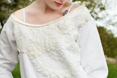 Take an old sweatshirt from drab to fab with crochet doilies.