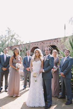 bridal party photo, long purple bridesmaid dresses, grey groomsmen suits, lace wedding dress, san juan capistrano wedding