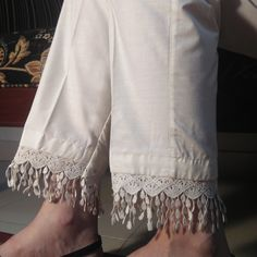 Off White / Cream Pure Cotton Trouser For Women With Laces. Comfortable to wear. Buy online from Zardi Pakistan delivery on cash. Salwar Designs, Kurta Designs Women, Kurti Designs Party Wear, Simple Pakistani Dresses, Pakistani Dress Design, Stylish Dresses For Girls, Stylish Dress Designs, Sleeves Designs For Dresses, Dress Neck Designs