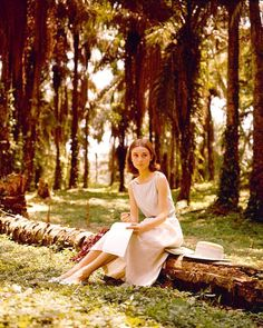 "Audrey writing a letter in a palm grove during the filming of ""The Nun's Story"" in the Belgian Congo, 1959"