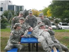 Cadets relaxing after assembling the picnic table