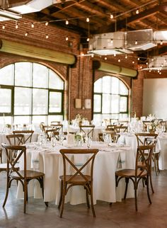 White and Teal Wedding Reception Decor with Wooden French Country Crossback Back Chairs, Teal Napkins, and String Lights | St Pete Wedding Reception Venue The Morean Center for Clay