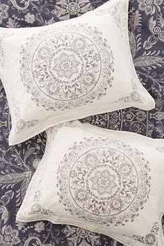 Set of 2 soft cotton pillow shams topped with a medallion motif we love. Perfect for a boho chic update to any bedding!