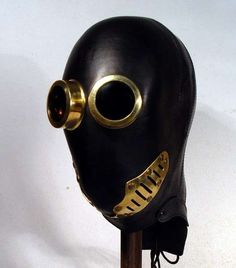 "another pinner says ""Dystopian Disguises - Bob Basset Boldly Blends Black Leather and Brass"""