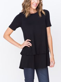 Let's give three cheers for the tunic with two tiers (and now sporting half-sleeves). This darling tunic adds lots of layers to your style as you pair it with your favorite cardi or wear it alone.30.5'' longHalf SleevesTunic lengthTwo Tiered TunicMade from 95% Rayon 5% Spandex with a 100% Polyester LiningWash Cold, Hang DryImportedModel is 5'7'' wearing a size Small
