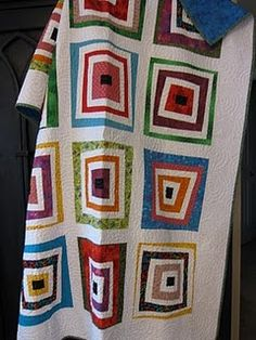 wonky scrappy log cabin quilt
