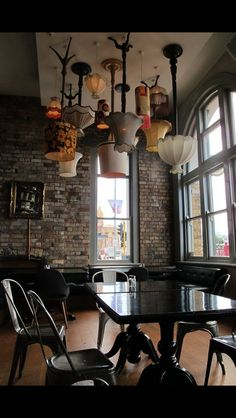Fun idea! Upside down lamps as lighting over a table