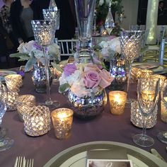 Silver lavender and lots of mercury glass in this detail from one of our tables. Romantic/glam/centerpiece/roses/ballroom/wedding/plum/hydrangeas/roses