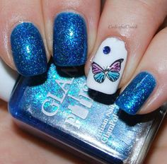 Blue gel glitter with butterfly nail art