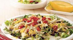 Taco Salad - Time-saving shortcuts, like rotisserie chicken, prepared dressing, crunchy chips, and pre-shredded cheese, make this salad easy and quick. Fresh summer tomatoes add great color and taste.