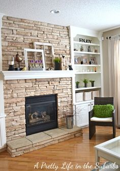 Stone fireplace, bookcase with cabinet below