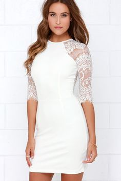 "When the sophisticated style of the Ivy League meets the sexy look of lace, you get the BB Dakota Princeton Ivory Lace Dress! Sheer lace sails across a sultry back panel, and down half sleeves that bell slightly on their way to scalloped cuffs. A sexy bodycon fit and rounded neckline are enhanced by soft ivory knit with a bit of stretch. Hidden back zipper/hook clasp. Unlined. Model is 5'8"" and is wearing a size x-small. Lace: 100% Nylon. 65% Rayon, 30% Nylon, 5% Spandex. Hand Wash Cold…"