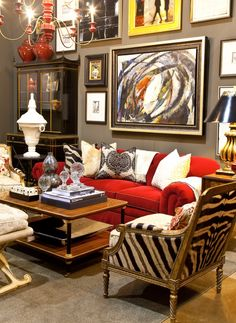 Love the red couch accented with pillows to bring the whole look together!
