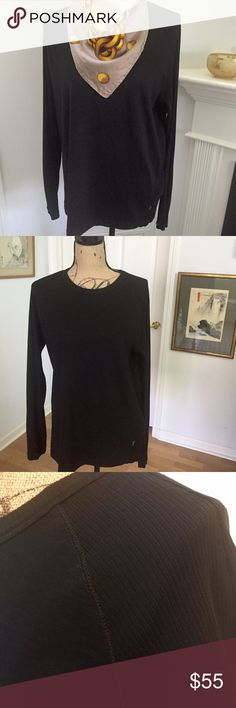 """Hugo Boss Sweater, Size Large Hugo Boss Sweater. 100% cotton, fine weave, black. This fine long sleeved sweater features a ribbed weave pattern accenting the sleeves and sides. I loved pairing it with jeans or tights for a luxurious yet relaxed style. It is marked XL  but it fits like a large. I wear a medium but was looking for an oversized look. Measures flat top to bottom 26-1/2"""", underarm to bottom 18"""", bottom width 19"""", shoulder to shoulder 17"""". I'm 5'3"""" and it hits me 2"""" below my hips…"""