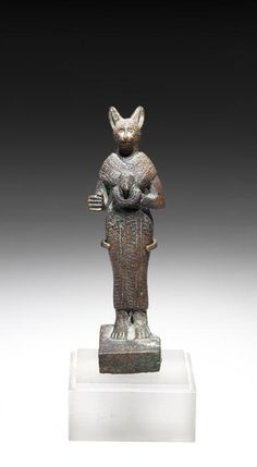An Egyptian bronze figure of Bastet. Late Period, circa 664-332 B.C.