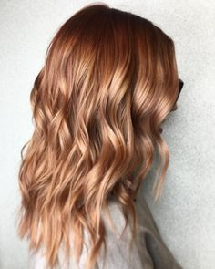 Dark strawberry blonde rose gold Aveda hair color by Aveda Artist Erinn Elizabeth.