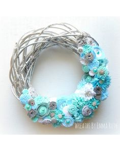 Chrome Painted Twig Wreath with handmade felt and fabric flowers. Perfect for winter with lots of sparkle.