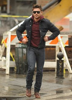 Zac wearing a dark double denim. The shades really make the outfit standout.