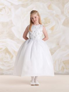 115307 Sleeveless satin and organza tea-length A-line dress with organza overlay bodice accented with hand-beaded three-dimensional motif and beaded waistband, beaded buttons down back bodice, full double layer organza overlay dirndl skirt, perfect as a First Holy Communion dress. Sizes: 6 – 14, 8 ½ – 14 ½ Color: White