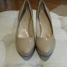 Nine West nude heel , really nice pair of Nine West high heel scuff on the back I have not tried to take it out these have a 4-inch heel 3/4 inch glass platform ,really nice  Nude color Nine West Shoes Heels
