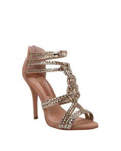 Strappy metallic heel.