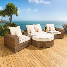 Luxury outdoor rattan garden furniture sofa set/group brown/cream 28. Truly stunning in design, this 4 seater sofa set gives a super high-class feel. This set consists 2 x end pieces, 1 x large middle sofa pieces, a large D shape footstool, 2 x wedge shape coffee table inserts, clips to hold them together, 4 x scatter cushions and heavy-duty covers in green. Call 02476 642139 or email sales@quatropi.com or visit www.quatropi.com for additional information.