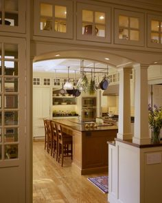 craftsman style kitchen, glass display cabinets, kitchen entrance, columns