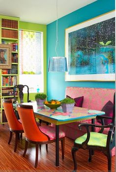 bohemian eclectic and bold!  Love the bright colors and mismatched chairs!