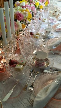 Pink depression glass and Fostoria American Clear Crystal place settings