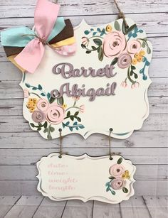 This sweet baby door hanger is made from 1/4 inch wood. The top measures 17.5x15.5 inches. The bottom is 12.5x5 inches. The childs name is cut out of wood and attached to the sign. The dimensions makes this piece pretty neat. This sign is hand painted. A rope hanger is added for Hospital Door Hangers, Baby Door Hangers, Wooden Door Signs, Diy Wood Signs, Newborn Announcement, Small Canvas Paintings, Laser Cut Jewelry, Nursery Signs, Baby Birthday