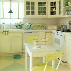 This kitchen's wood floors sport a diamond pattern of green and cream. | Coastalliving.com