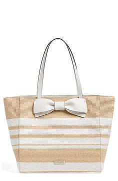 Adoring this spacious Kate Spade tote woven from straw for a beachy feel.