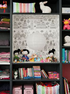 Wonderful shelving for a kids bedroom...love the little houses wallpaper.