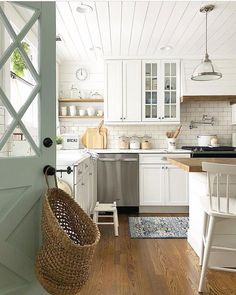 That door. That kitchen. Love it all!  So fresh and inviting! Have you heard about our Welcome 2018 sale? ...up to 40% off STOREWIDE and shipping is ALWAYS FREE! Sale ends soon! PaintedFoxHome.com  Our top-selling BREAD Box is such a staple farmhouse piece!  credit goes to our customer Loren at @bluebarnandcottage !  #wehavethebestcustomersonearth #farmhouseswag #paintedfoxfamily #paintedfoxhome #decor #farmhousestyle #farmhousedecor #farmhouse