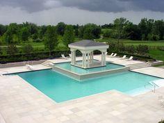 Limestone pool deck and patio w/ outdoor sitting area. Gazebo on an island w/ negative edge landscaping design & Installation