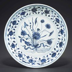 A rare early ming blue and white 'lotus bouquet' dish. Yongle period