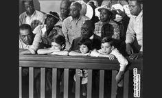 Chapter 21: Calpurnia comes into the courtroom to hand a note to Atticus. The note was saying that they didn't know where the kids were. They find out though that they were up sitting in the balcony with all the black folks. The kids went home to eat lunch and then came back. Later on, Atticus leaves the room and the black folks stand up out of respect for Atticus. They understand the sacrifice Atticus made to take this case.