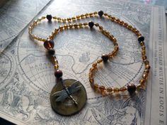 Rosary inspired necklace with golden glass beads and by DreamSand, kr350.00