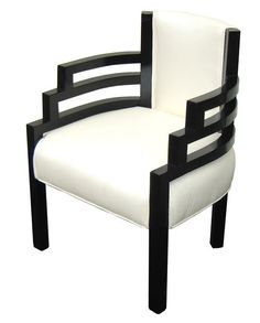 """Stylish and comfortable streamline design armchair was designed by Karl Emmanuel Martin (KEM) Weber (1889 -1963) in the 1930's. Finished in high gloss black lacquer and pearly white leather, the chair is the height of American Modern art deco. The """"Stair-step"""" curved arms offer a contrast to the vertical lines of the legs and back. The chair measures 20 ½"""" wide x 22"""" deep and 33 ½"""" high"""