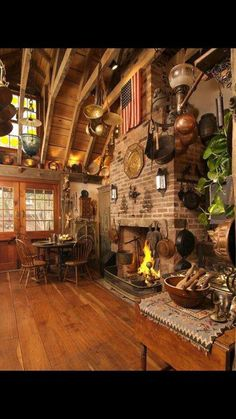 This photo shows country design by the open beam, wood floors, cool fireplace, and how it makes you feel as if the room is cozy.
