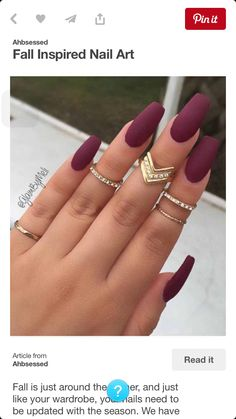 Maroon nails and gold rings
