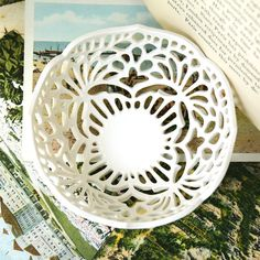 White porcelain bowl with delicate lace-inspired carving. Measures approximately 3.75 wide and 1.5 tall. Glazed with milky white, food-safe,