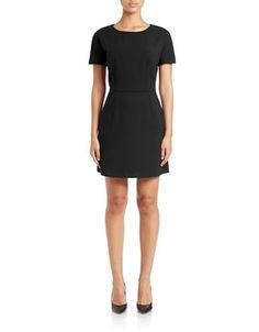 """<ul> <li>A simple yet sophisticated A-line silhouette </li> <li>Round neck</li> <li>Short sleeves </li> <li>Two front slash pockets </li> <li>Back zip closure</li> <li>Lined</li> <li>About 18"""" from natural waist</li> <li>Polyester/viscose/elastane </li> <li>Dry clean</li> <li>Made in USA </li> </ul>"""