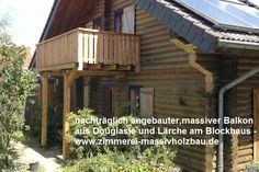 massiver Holzbalkon aus Douglasie und Laerche am Blockhaus, Massivholzhaus in NRW - Köln, Bonn, Siegburg, Lohmar, Leichlingen, Bergisches Land