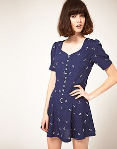 ASOS Fashion Finder | Nishe Sweetheart Dress in Anchor Embroidery  Featuring a contrast anchor print design, sweetheart neckline, gathered detailing to the shoulders, short sleeve styling, button through fastening to the front, a gently flared skirt and a shirred panel to reverse. Designed with a mini cut length