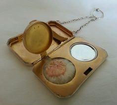 A sterling silver Combination Compact,mirror and cigarette case.Birmingham 1912.
