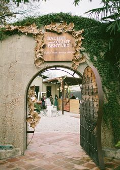 A vintage outdoor wedding entrance sign