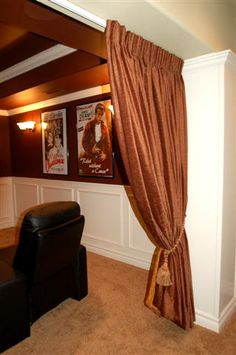Like the wainscoting, sconce lighting, crown molding, movie posters & drapes